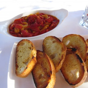 Roasted red peppers and toated French Baguette in olive oil