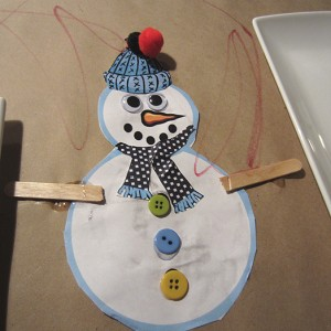 Making snowman cut-outs to decorate brown lunch bags.