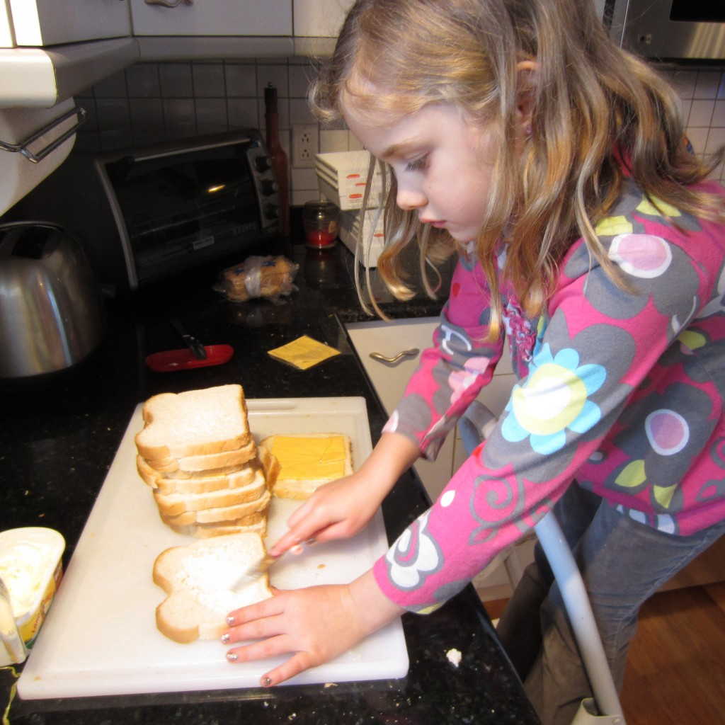 Buttering bread for Grilled Cheese Sandwiches