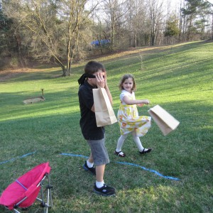 Olivia guiding her big brother through the obstacle course.