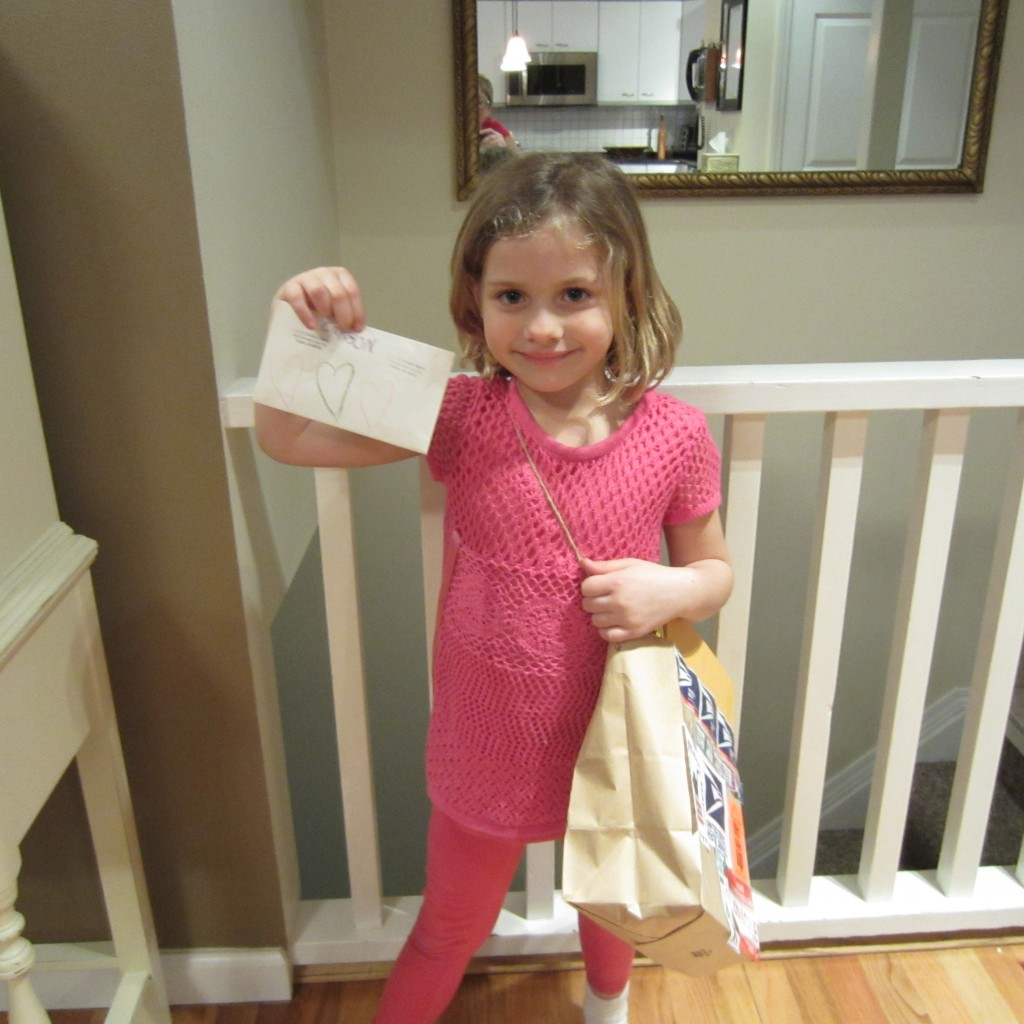 Olivia delivering mail from her hand made carrier bag.