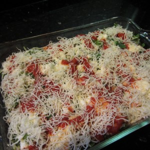 Final layer is shredded mozzarella cheese.