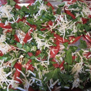 Sprinkle cheese on top of the spinach tomato mixture.