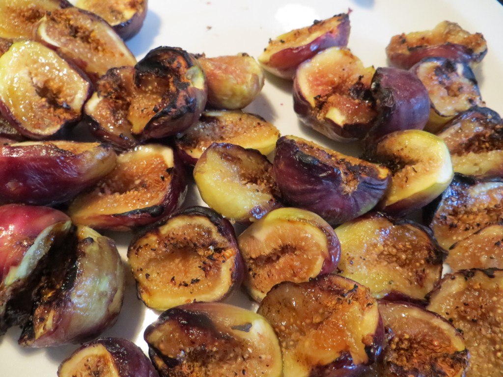 Grilled figs ready to fill with goat cheese.