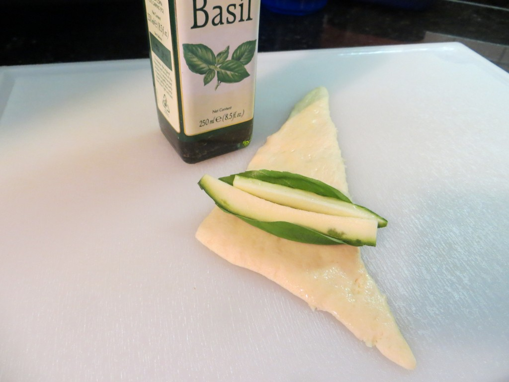 Place zucchini slices, basil leave on crescent.
