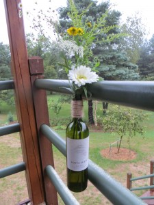 Hanging flower vase wine bottles