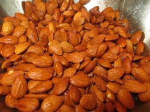Coat the raw almonds in egg white